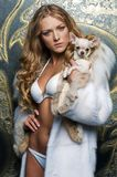 Beautiful blonde with small dog Royalty Free Stock Photography