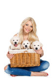 Beautiful blonde with a small white puppy of Labrador Stock Image