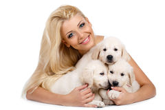 Beautiful blonde with a small white puppy of Labrador Stock Photos