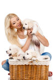 Beautiful blonde with a small white puppy of Labrador Royalty Free Stock Photography
