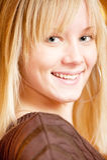 Beautiful blonde smiles Stock Image