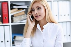 Beautiful blonde smiling businesswoman talk cellphone. In office portrait. Stay in touch best cellular price white collar busy life style electronic device Stock Images