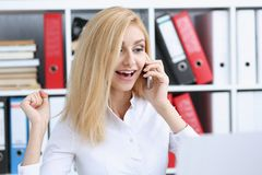 Beautiful blonde smiling businesswoman talk cellphone. In office portrait. Stay in touch best cellular price A woman is informed that she won a prize in the Stock Image