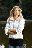 Beautiful blonde smiling by lake Royalty Free Stock Photos