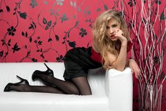 Beautiful blonde on the sofa stock image