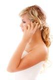Beautiful blonde speaks by Royalty Free Stock Image