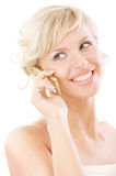 Beautiful blonde speaks by telephone and smiles. Isolated on white background royalty free stock photo