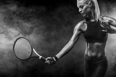 Beautiful blonde sport woman tennis player with racket in red costume stock images