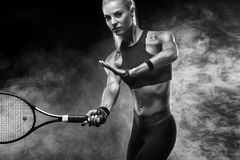 Beautiful blonde sport woman tennis player with racket in red costume royalty free stock photo