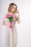Beautiful blonde spring girl with flowers Royalty Free Stock Photo