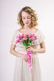 Beautiful blonde spring girl with flowers Royalty Free Stock Image