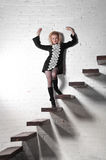 Beautiful blonde on stairway Royalty Free Stock Photos