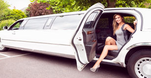 Beautiful blonde stepping out of limousine Royalty Free Stock Photos