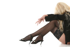 Beautiful blonde in stockings. On white background Royalty Free Stock Photo