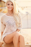 Beautiful blonde on the street of the city. Royalty Free Stock Photography