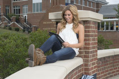 Beautiful blonde student on campus Stock Images