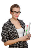 Beautiful blonde student girl with books and a pen Royalty Free Stock Photos
