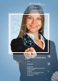 Beautiful blonde in suit pointing finger on virtual grid. Frame and text. Blue background Stock Image