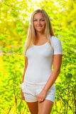 A beautiful blonde in a summer forest Royalty Free Stock Images