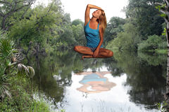 Beautiful Blonde Suspended Above River stock photo