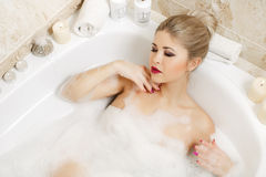 Beautiful blonde takes a bath. Royalty Free Stock Photography