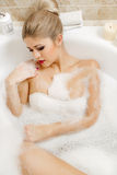 Beautiful blonde takes a bath. Stock Images