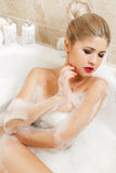 Beautiful blonde takes a bath. Stock Image
