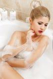 Beautiful blonde takes a bath. Stock Image