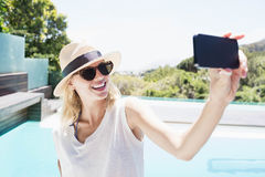 Beautiful blonde taking selfie Royalty Free Stock Photography