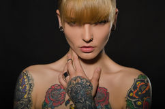 Beautiful blonde with a tattoo on body Royalty Free Stock Images