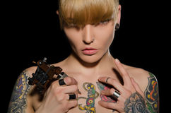 Beautiful blonde with tattoo machine and for them Stock Photo