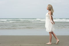 Beautiful blonde teenage girl on beach Stock Photos