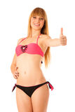Beautiful blonde teenage girl showing thumb up as a sign of allr Royalty Free Stock Image