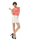 Beautiful blonde teenager in cool skirt isolated Royalty Free Stock Photos