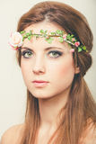 Beautiful blonde with tiara of roses Royalty Free Stock Photography