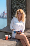 Beautiful blonde tourist on the famous bridge in Budapest Royalty Free Stock Images