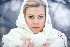 Beautiful blonde in a traditional Russian winter snow Royalty Free Stock Photos