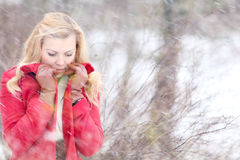 Beautiful blonde in a traditional Russian winter snow Royalty Free Stock Photo