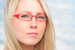 Beautiful blonde tries on glasses Stock Photos