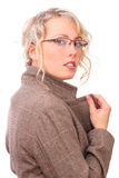 Beautiful blonde tries on glasses Stock Photography