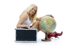 Beautiful blonde with valise and globe. On isolated background Royalty Free Stock Photography