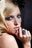 Beautiful blonde in veil. Glamour portrait of beautiful blonde retro girl in veil on dark stock photography