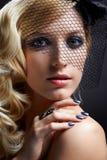 Beautiful blonde in veil Stock Images