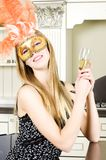 Beautiful blonde in a venetian mask Royalty Free Stock Photo