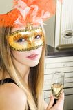 Beautiful blonde in a venetian mask Stock Photo