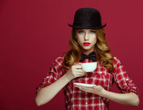 The beautiful blonde in a vintage hat. Stock Photo