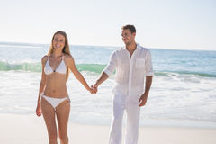 Beautiful blonde walking away from man holding her hand Royalty Free Stock Photos