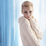Beautiful blonde wearing a warm wool sweater Stock Photography