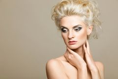 Beautiful blonde on the white background royalty free stock photo