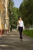 Beautiful blonde in a white blouse and a hat Royalty Free Stock Photo